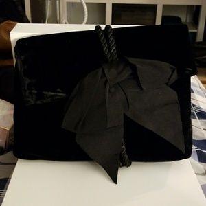 Ann Taylor Black velvet clutch with bow